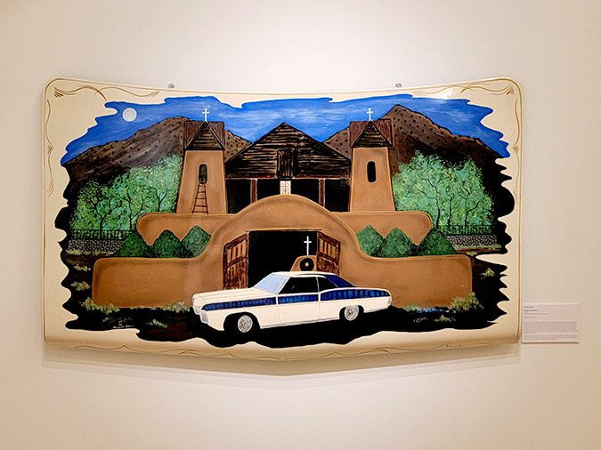 Custom car hood painted with picture of the Santuario at Chimayo