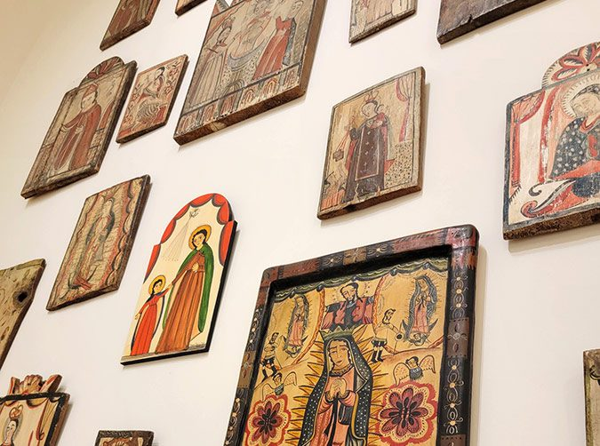 Collection of retablos hanging on a wall